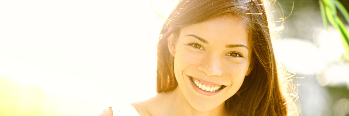 Asian woman smiling happy on sunny summer