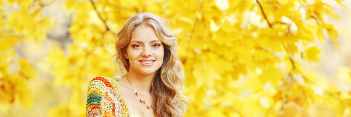 Beautiful blond woman posing in autumn park