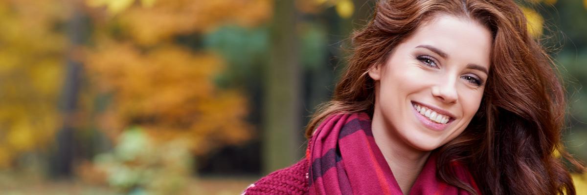 Portrait of beautiful brunette girl walking the park